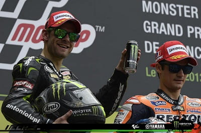 Crutchlow grimaces with pain as he mounts the podium. It can't be long until he's on the top step.