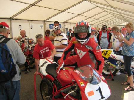 Carl Fogarty climbs onto his Ducati