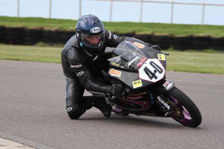 Knee down at Anglesey on Joe's RS125R
