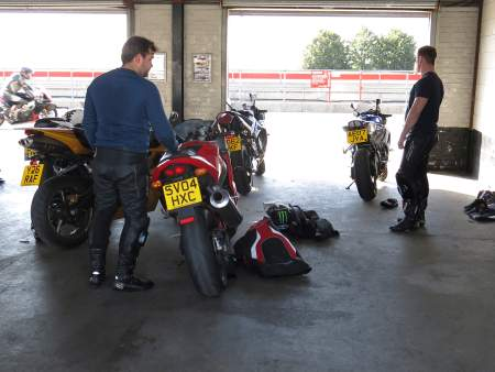 Sam and Dan prepare in the pit garage