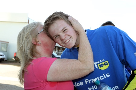 Joe's mum kisses him well done