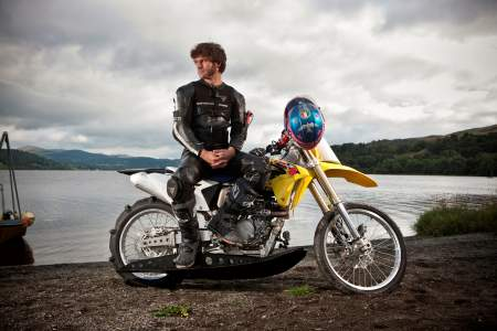 Guy Martin poses with his adapted Suzuki ready to ride on water