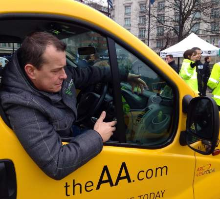 McGuinness admires the AA's Think Bike sticker