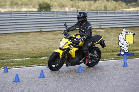 Kawasaki's ER-6n feels nimble around the cones on Michelin's test facility