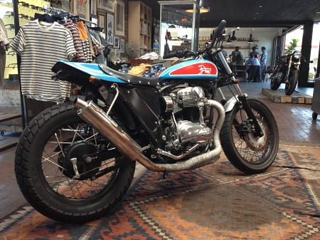 W650-based street tracker is called Street Tracker STP with a colour scheme based on a NASCAR. It features a street tracker seat unit and tank, plus pipe wrapping and a full race exhaust system.