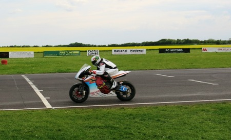 McGuinness flying on the Mugen TT Zero bike