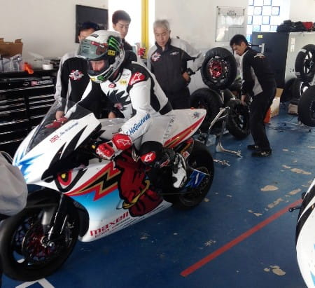 John McGuinness 'wooshes' out of the pit garage
