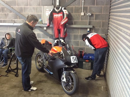 Ducati Glasgow owner Martin Rees in the black jacket on the left, while Niall Mackenzie takes a look at the bike.