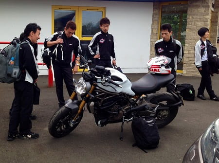 Monster gets admiring looks from Mugen's staff when it was used to get to a Mugen electric TT bike test.
