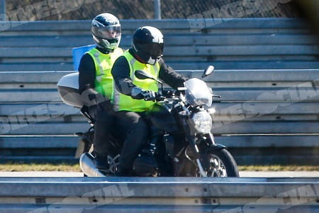 BMW's R1200R spied on test. We reckon the pillion is looking straight at the photographer, what do you think?