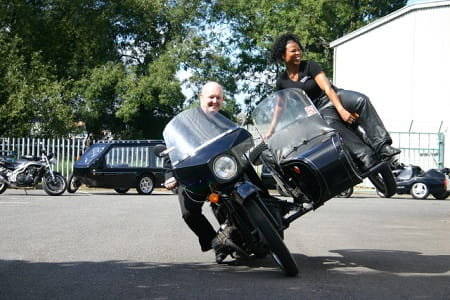 Reverend Paul Sinclair and Marian Sinclair having a bit of two-wheel fun!