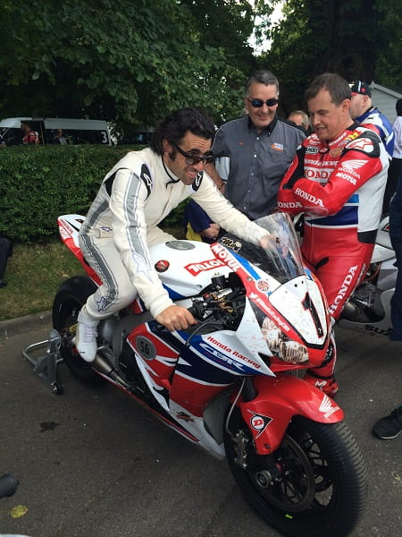 Indy car star Dario Franchitti tries McGuinness' 2014 TT bike for size.