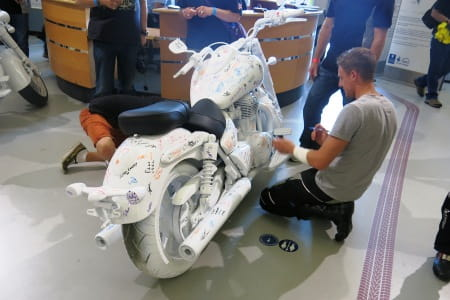 Anyone could sign one of two bikes, they'll be lacquered and displayed