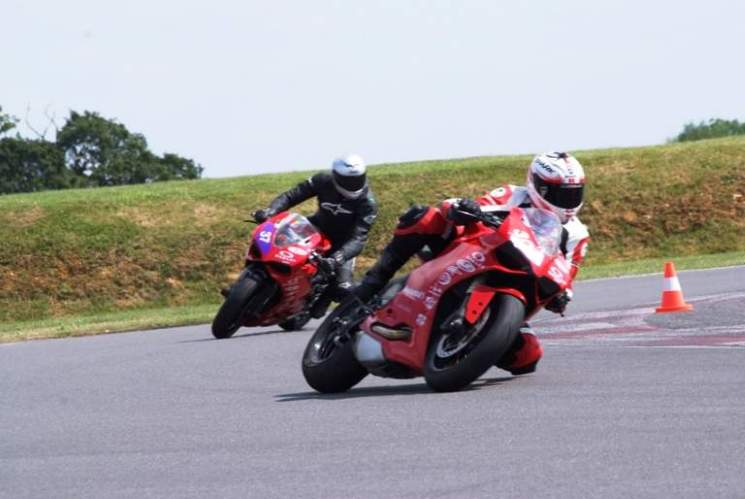 Instructors lead the way around Silverstone's Stowe circuit