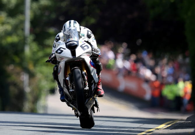 Mr Dunlop gives it full gas over Ago's Leap at the 2014 TT