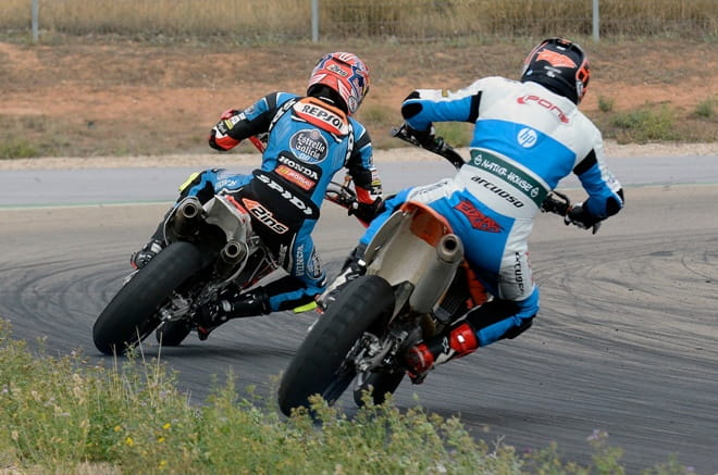 Alex Rins and Edgar Pons both backing it in