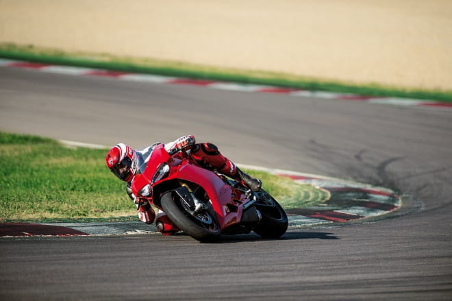 Ducati's test rider does his best to get his elbow down on the new 1299 Panigale. He can check his lean angle monitor when he gets back to the pits.