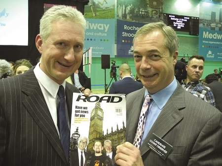 Lembit Opik and Nigel Farage fight over a copy of ROAD