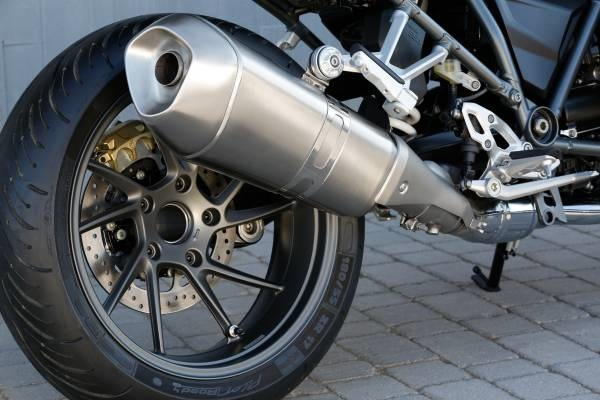 Exhaust is designed to allow decent levels of lean angle before touching down.