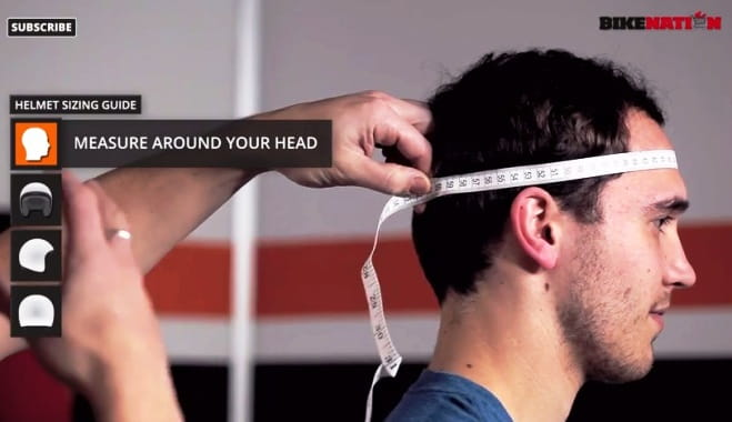 Put a tape measure around the largest part of your head