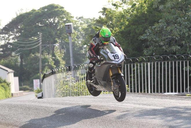 Cameron Donald flies over Ballaugh on Norton's SG3