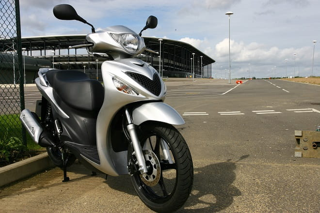 Averages 60-70mpg, nowhere near as good as more modern scoots