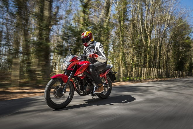 Honda CBF125 takes on Goodwood Hillclmb. Classy shot, eh?