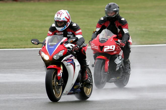 Ron Haslam leads the way on a Fireblade SP at a wet Donington Park