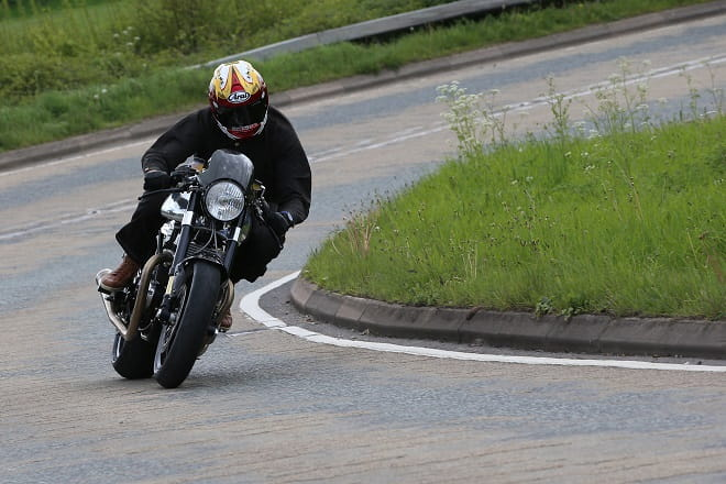 Head down, on the pipe. Norton Dominator SS Number One attempts to wake up Leicestershire.