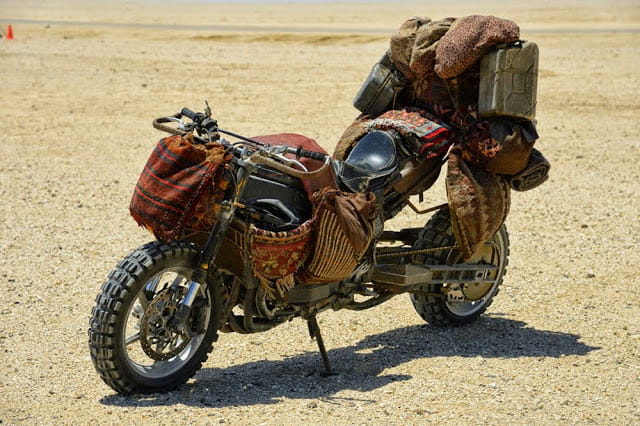 Knobblies, carpet, petrol cans bolted on? That'll be an R1 in the new Mad Max movie then!