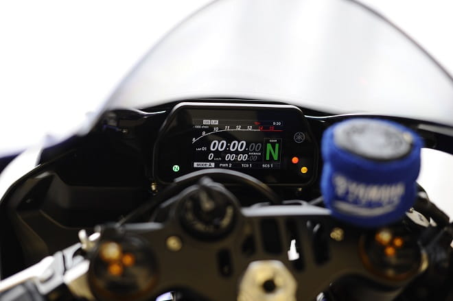 R1 clocks start at 8000rpm. Yamaha Racing wrist band to stop any brake fluid leaks is just like Valentino's bike.