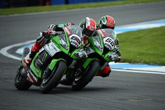 Sykes (left) wins at Donington but Rea leads the Championship
