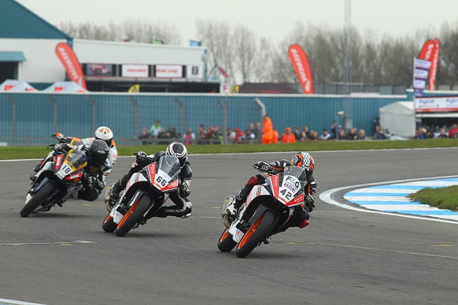 Race action at Donington Park of the teenagers at war