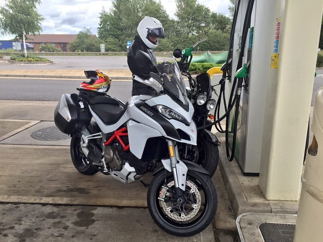 Mann fills-up the Rocket, dreading his pillion ride back to the office. It surprised him how comfortable it was.
