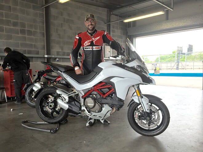The Multistrada at Donington Park, and a beaming Potter about to cut some laps on a session.