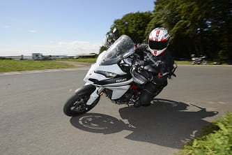 Tour the word then sling it around a road race track - multi purpose Multistrada
