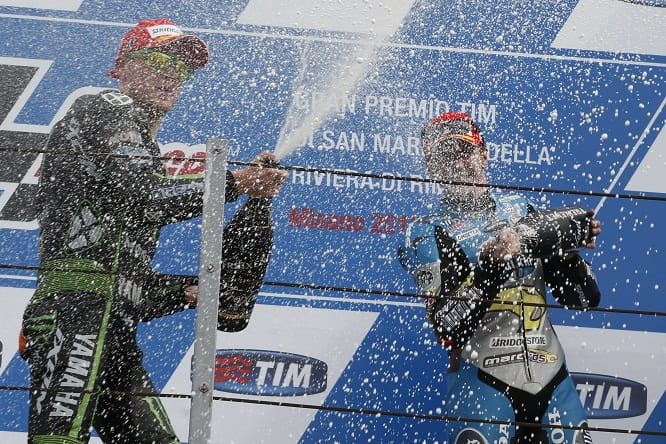 Redding celebrates with second placed Bradley Smith, the first time two Brits had been on the podium since 1979