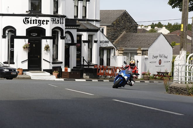 Hamming it up for the camera at Ginger Hall on the Suzuki GSX-S1000F on a lap of the TT course.
