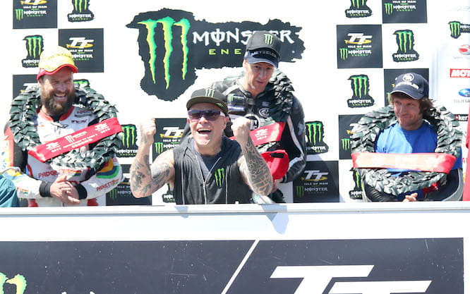 Prodigy front man and team boss Keith Flint celebrates on the podium in 2015