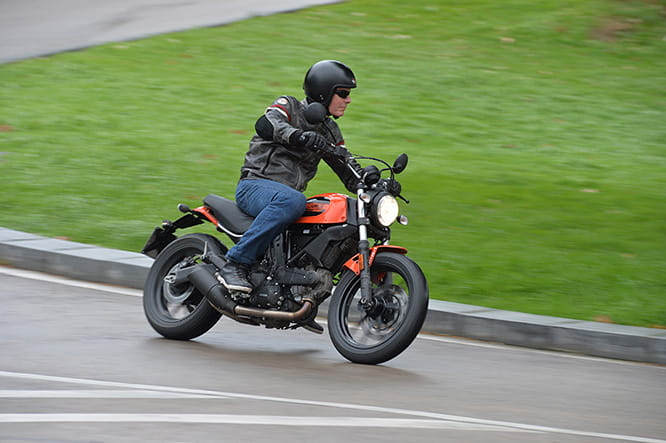 Roland Brown pounds the wet Barcelona streets on the A2 licence friendly 399cc Scrambler Sixty2