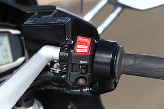 Rocker style ignition, riding modes and hazards on the right