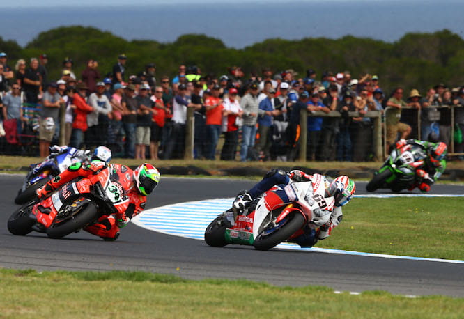 Hayden attempts to hold of Ducati's Giugliano