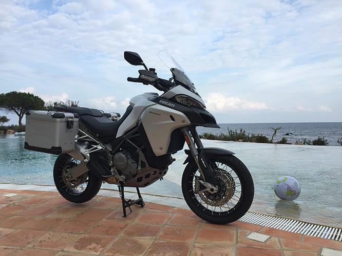 A Ducati Multistrada 1200 parked by the pool on a warm March day in Sardinia, makes you want to just get on and ride it off. Thankfully our man has, and yes we hate him too.