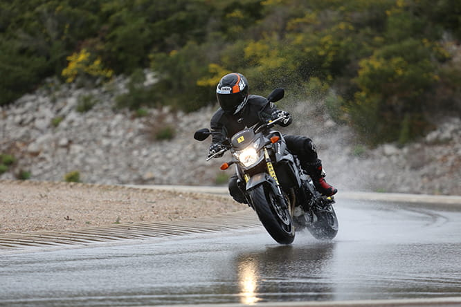Bike Social's Paul Taylor on a Suzuki GSR750 on the wet handling track at Dunlop's testing facililty