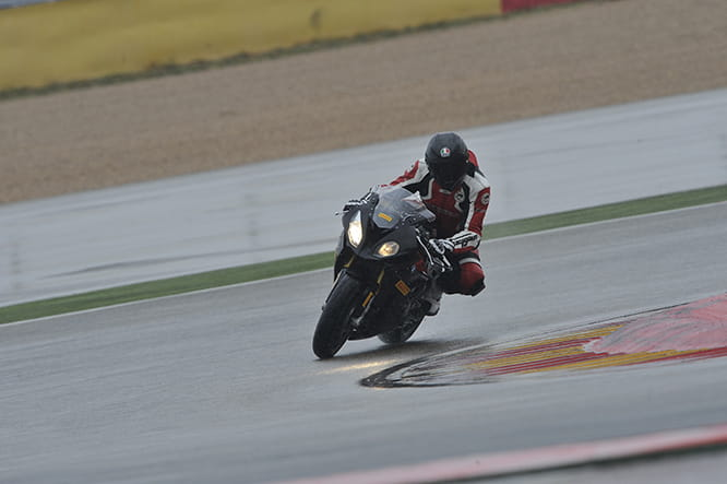 Tipping the S1000RR in despite the pouring rain