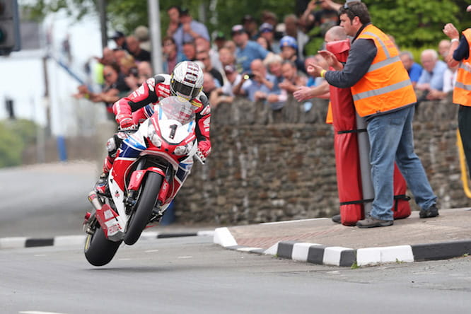 John McGuinness powers home to his 23rd TT victory in 2015