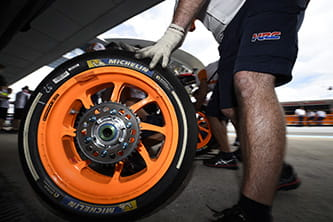 Honda mechanic with Michelin MotoGP tyre