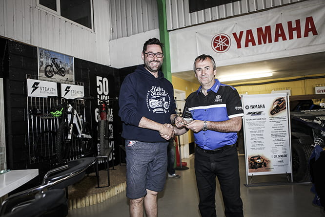 Bike Social's Potter takes the third place trophy from Yamaha's Jeff Turner, they're smiling now, but the crash bill hasn't been put in the post yet.