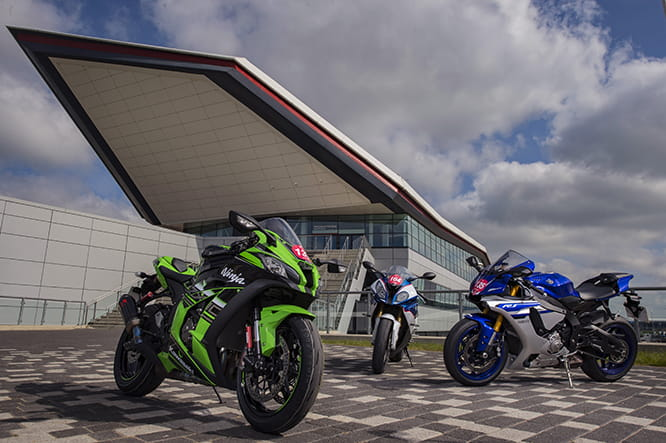 In front of the iconic Wing at Silverstone the trio await their track time