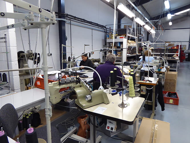 Part of the manufacturing area inside the factory. Some of the sewing machines cost upwards of £9000.
